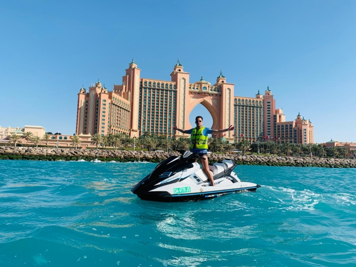 group of friends on their jet ski in front of the Burj Al Arab