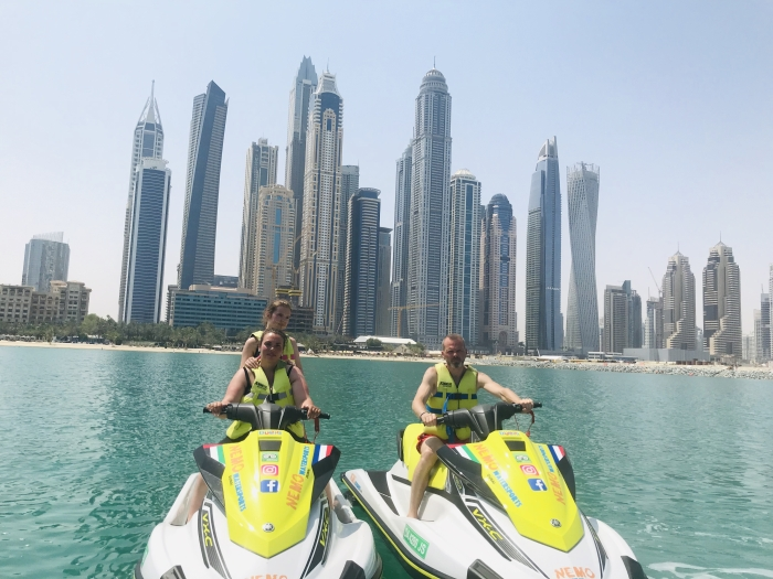 2 customers during a jet ski stop at Dubai Marina
