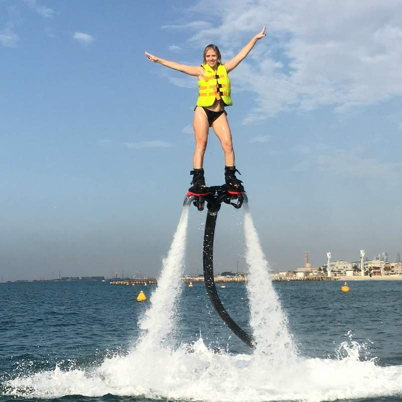 a female client on the flyboard during a session