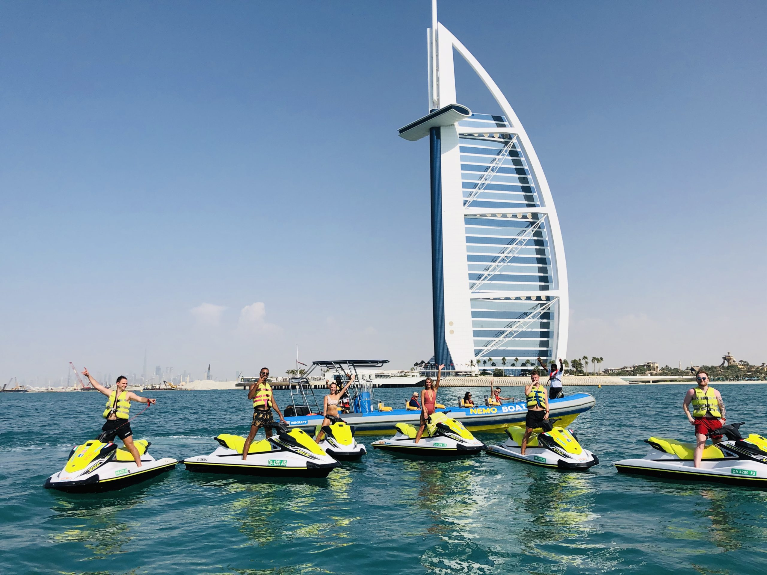 customers during a jet ski stop in front of the Burj Al Arab